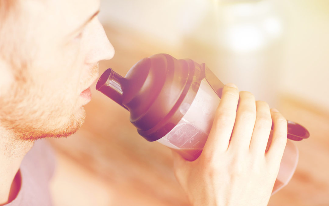 close up of man drinking protein shake to illustrate Bariatric Protein Shakes