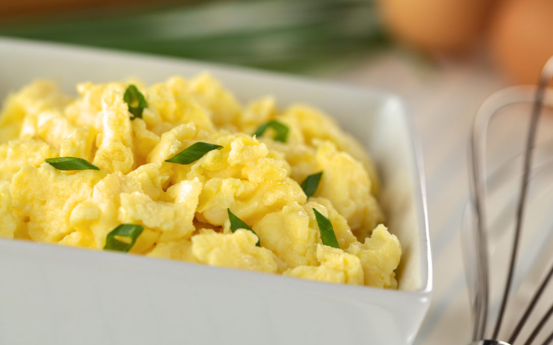 Scrambled eggs with green onion in bowl to illustrate Bariatric Soft Food Breakfast Ideas