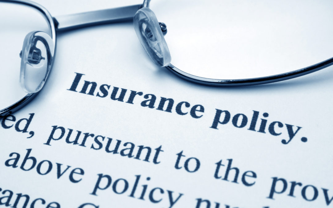 closeup of insurance policy to illustrate How Do You Qualify For Bariatric Surgery