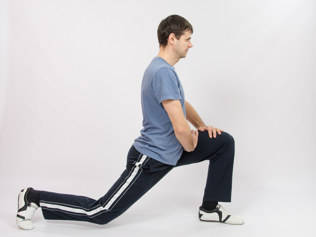 The athlete performs squats as suggested by his personal trainer
