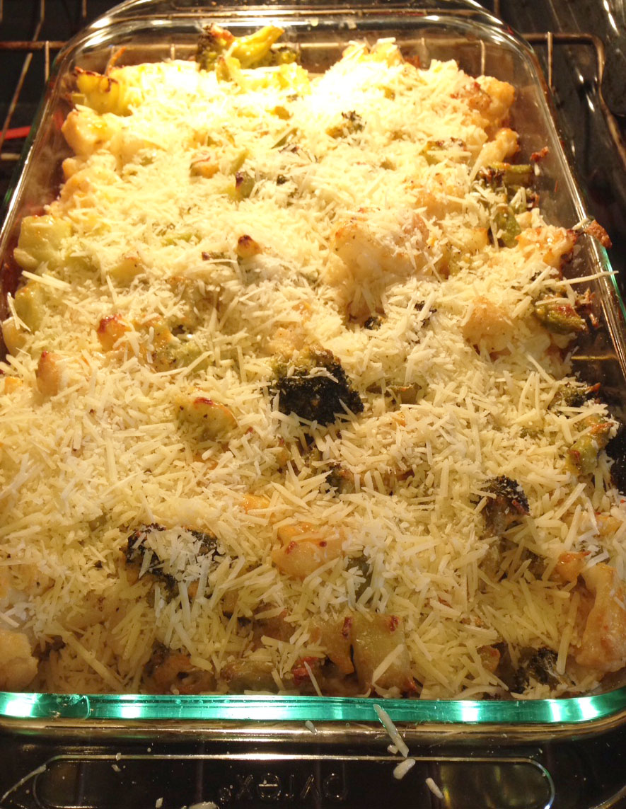 Remove from the oven and top with shredded parmesan cheese. Return the ...