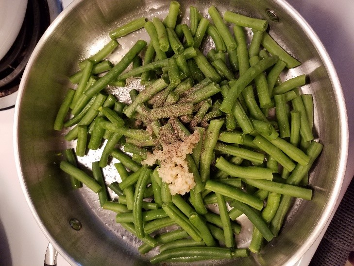 green beans cooking in a pan