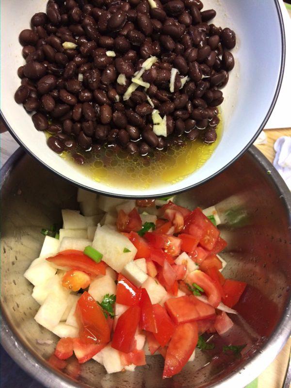 pouring salad together
